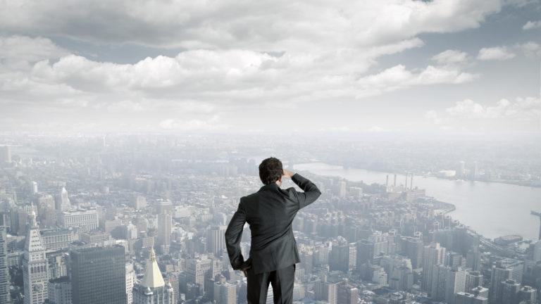 Man Overlooking City